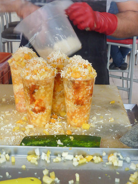 adding the cheese to gaspachos morelianos