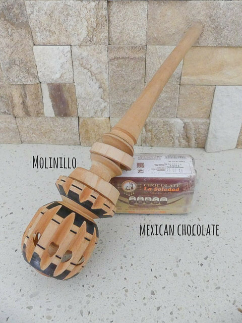mexican hot chocolate and a wooden molinillo for mixing