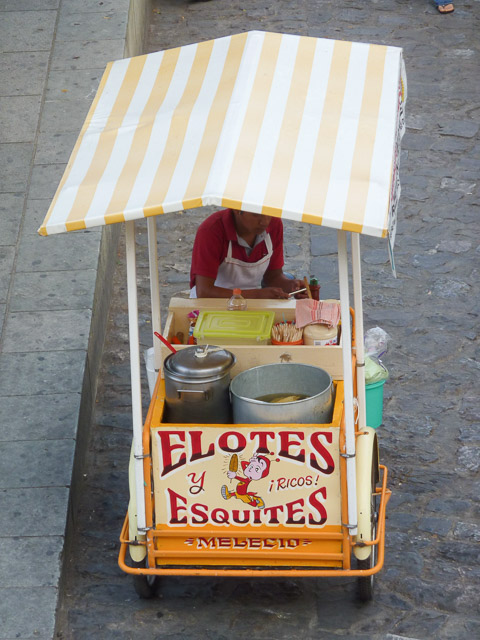 vendor selling elote and esquites street corn in Mexico