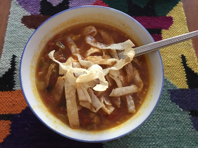 mexican puuled prok soup with shredded pancakes on tope