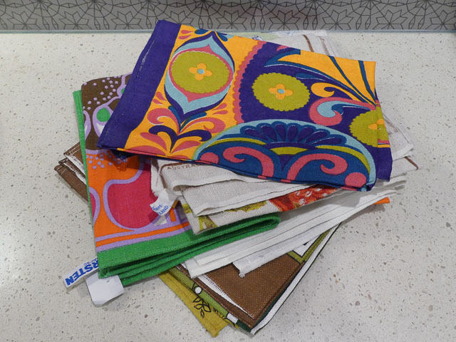 pile of colourful tea towels