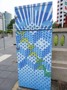 traffic signal box painted with abstract pattern in muted blue tones, Brisbane