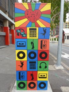 traffic signal box painted with simple icons in primary colours, brisbane