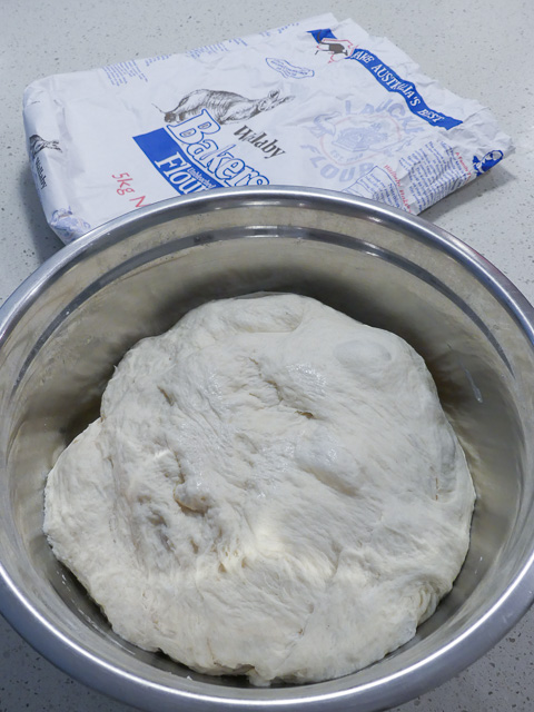 large ball of dough in bowl with wallaby flour bag in the background