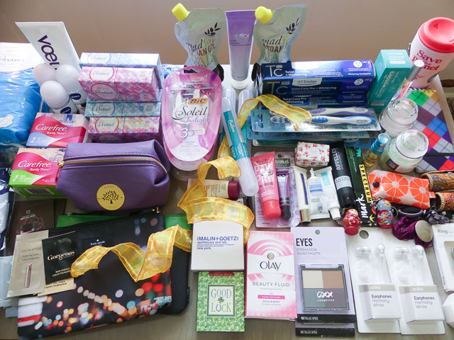 small gifts and women's hygiene products piled on table for donating