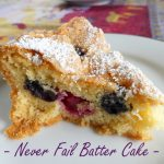 slice of blueberry and rapebrry batter cake dusted with icing sugar