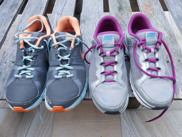 two pairs of running shoes for donating with purpose