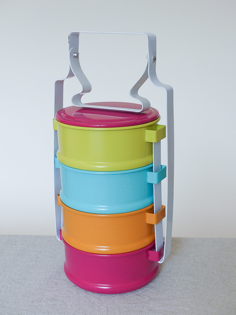 brightly coloured 4 tier tiffin box