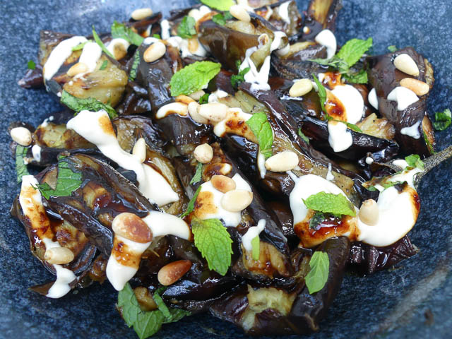 middle eastern eggplant salad with mint and pine nuts scattered on top