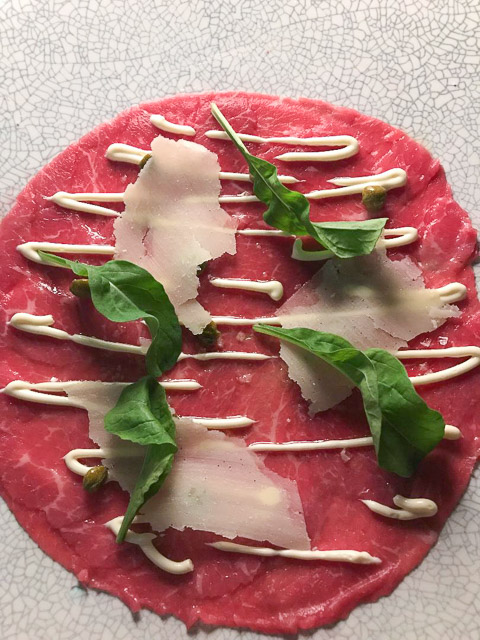 beef carpaccio with parmesean curls and rocket