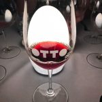 otto branded wineglass sitting in front of table lighting