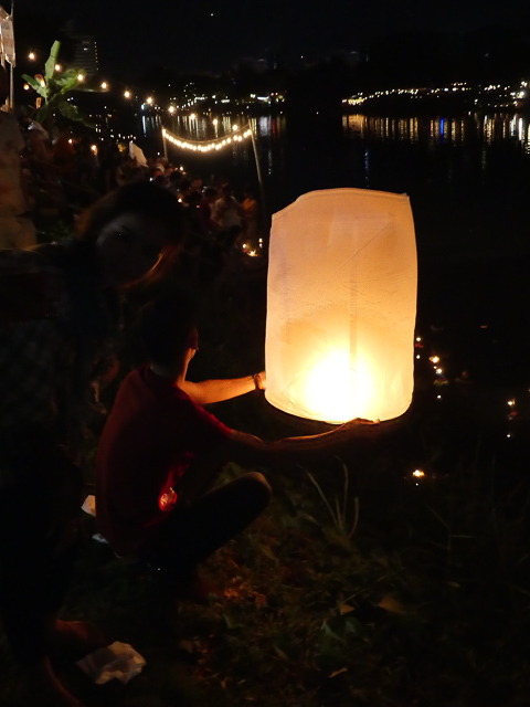 rice paper latern being relased into night sky in Chiang Mai