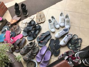 dozens of shoes, sandals and thongs outside a chiang mai massage centre