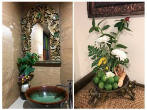 chiang mai massage facilities including ceramic wash basin and mirror and floral offering with galangal and limes