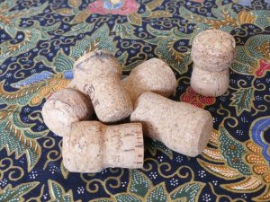 six bottle corks piled on table