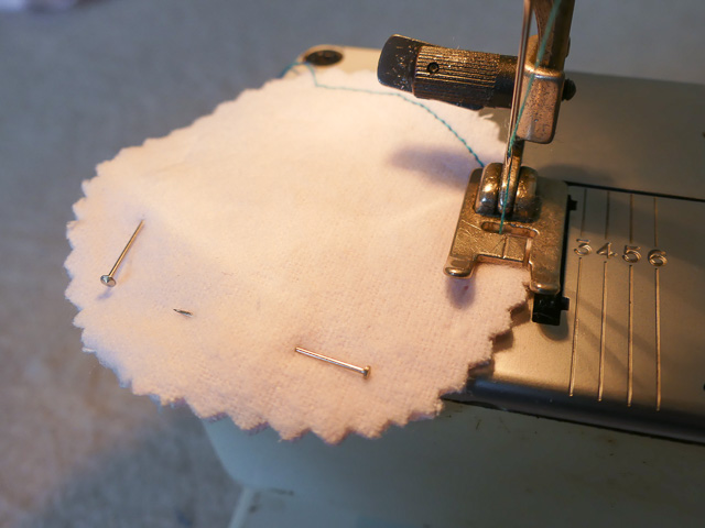 round fabric pinned and mebing machine stitched to make reusable makeup pad