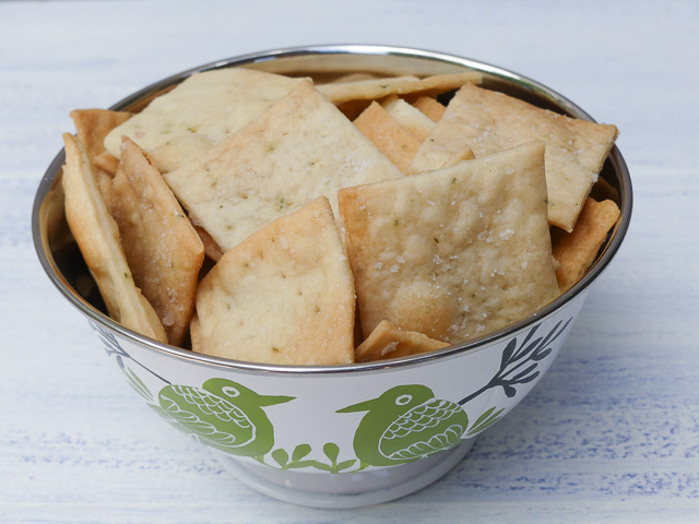 metal bowl containing square sourdough crackers