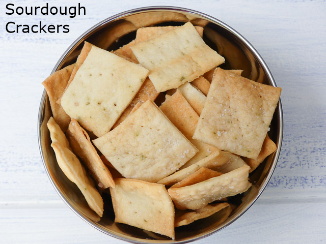 square crackers in a metal bowl observed from above