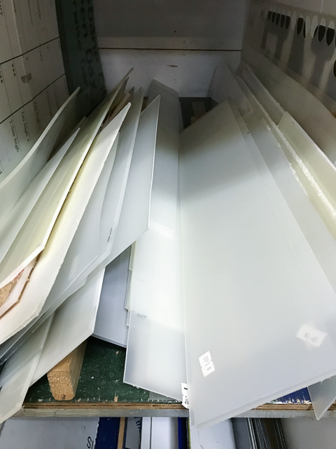 pieces of rectangular white acrylic stacked together