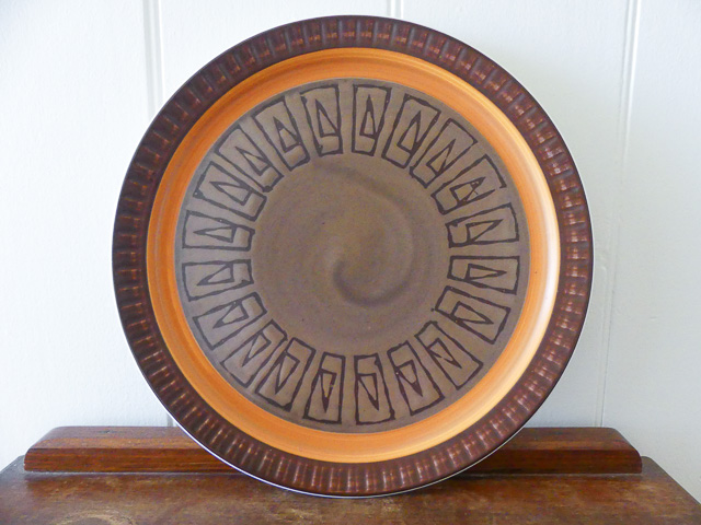 brown and orange stoneware plate with Greek design purchased when op shopping