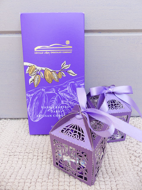 block of chocolate in purple cardboard wrapper with gold writing