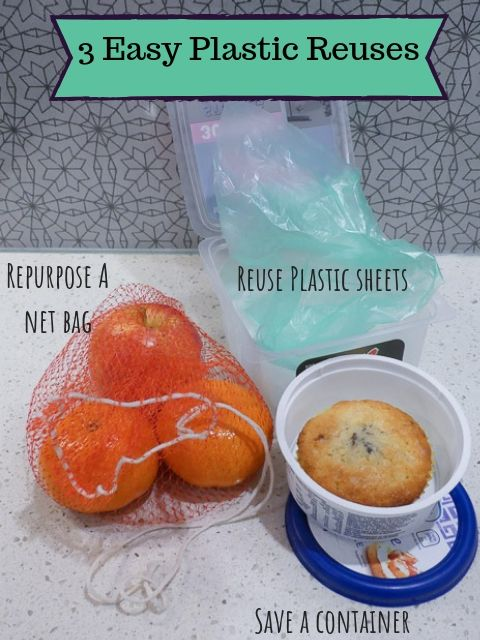 small plastic container with sweet muffin inside, plastic mesh bag with fruit inside and plastic box with plastic sheets