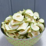 large green bowl of dried green apple slices