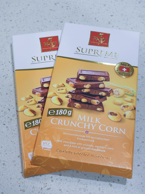 two blocks of swiss crunchy corn milk chocolate