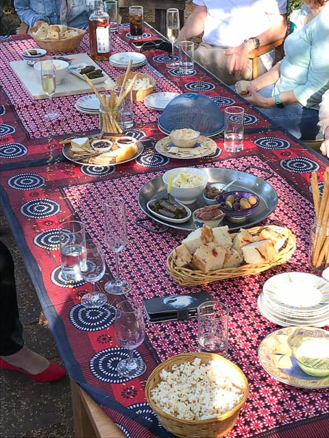 long table laid with mezze platters and wine glasses
