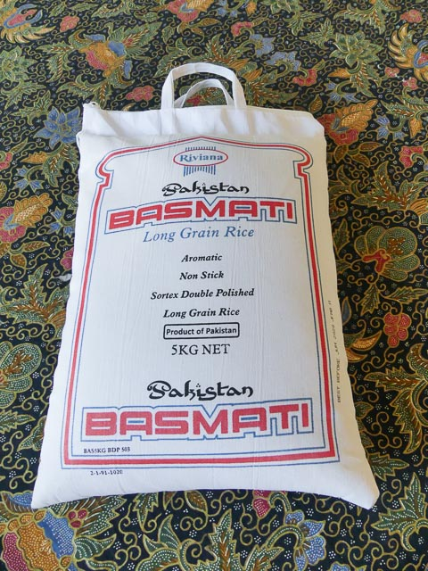 large five kilo bag of white rice in white cotton bag