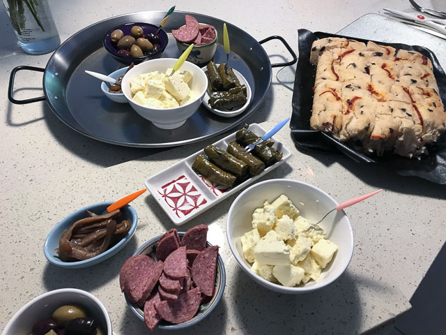 mezze platters with olives, dolmades, feta cheese and focaccia