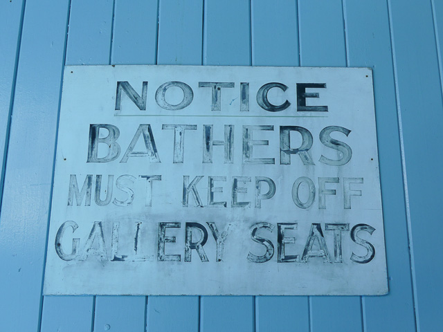 original sign in spring hill baths stating 'bathers must keep off gallery seats'