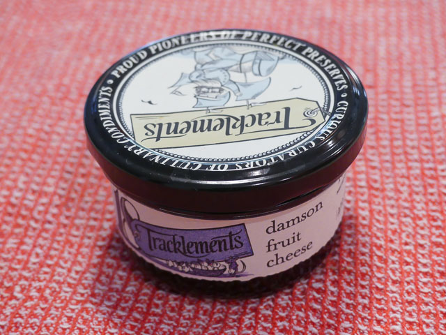 small glas jar of damson fruit cheese with meatl lid branded with Tracklements logo